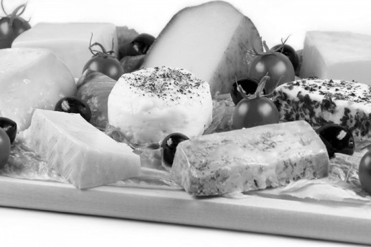 various cheeses on a cheese board